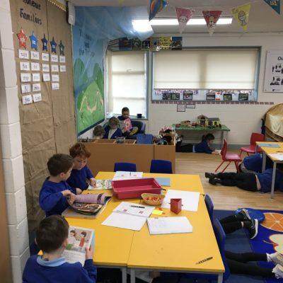 Class 1, some children enjoying reading under their tables!